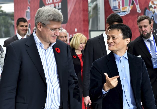 Alibaba Group Executive Chairman Jack Ma gestures as he speaks to PM Harper on Nov. 7, 2014. (Reuters)