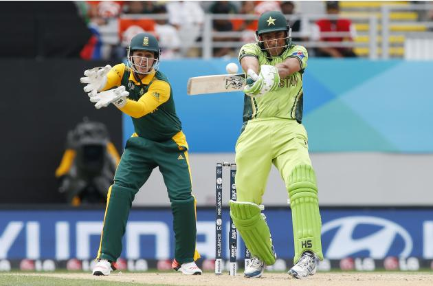 Pakistan's Khan hits a four watched by South Africa's De Kock during their Cricket World Cup match in Auckland