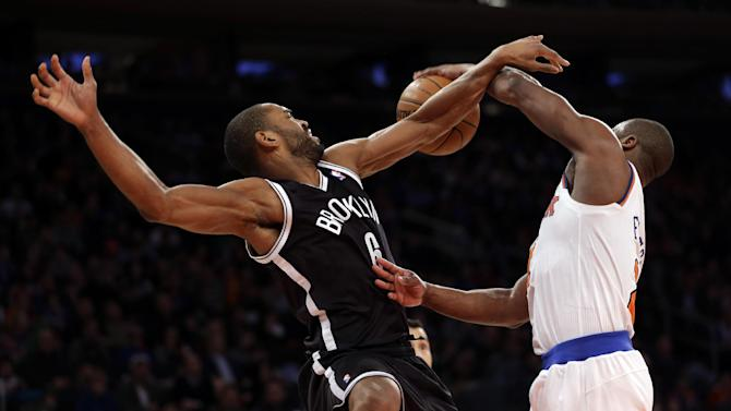 Brooklyn Nets' Alan Anderson, left, is fouled by New York Knicks' Raymond Felton during the second half of the NBA basketball game at Madison Square Garden, Monday, Jan. 20, 2014, in New York. The Nets defeated the Knicks 103-80