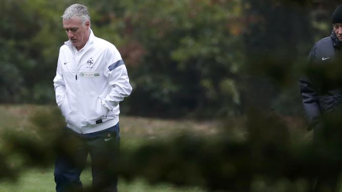 France's national soccer team coach Deschamps arrives for a news conference at the training camp in Clairefontaine