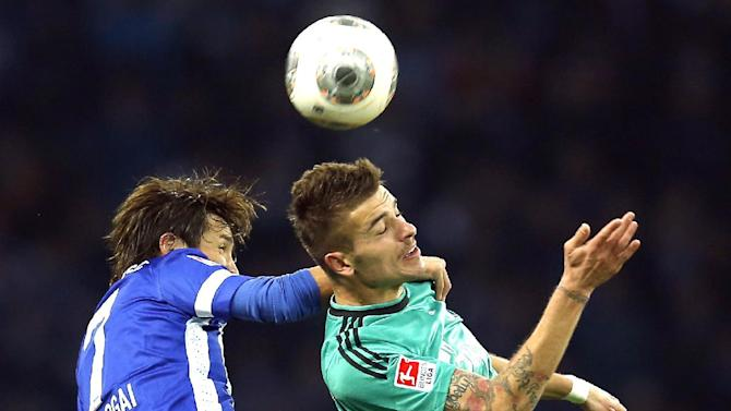 Berlin's Hajime Hosogai of Japan, left, and Schalke's Roman Neustaedter , right, challenge for the ball during the German first division Bundesliga soccer match between Hertha BSC Berlin  and FC Schalke 04 in Berlin, Germany, Saturday, Nov. 2, 2013