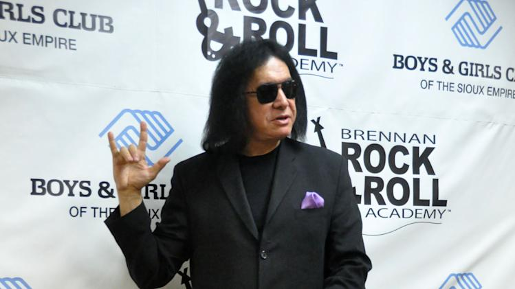 Gene Simmons, the lead singer of the rock band Kiss, makes an unannounced appearance at a fundraiser concert at the Brennan Rock & Roll Academy, Saturday, Mar. 30, 2013, in Sioux Falls, S.D. (AP Photo/Dirk Lammers)