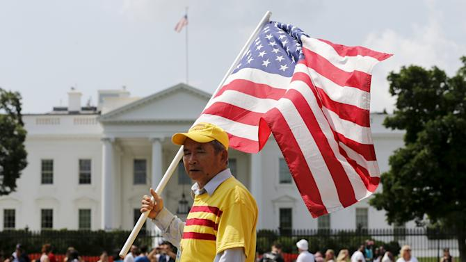 "Demonstrators shouting ""Freedom for Vietnam"" rally outside the White House as Obama meets inside with Trong in Washington"