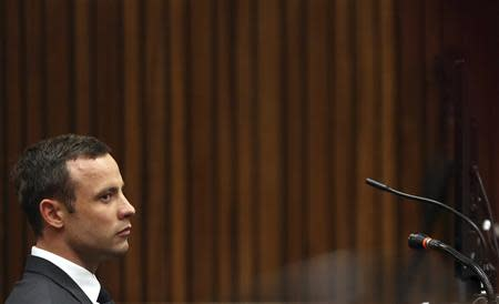 Pistorius sits in the dock during the fifth day of his trial in Pretoria