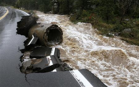 A section of Highway 72 is missing after a flash flood tore through Coal Creek near Golden