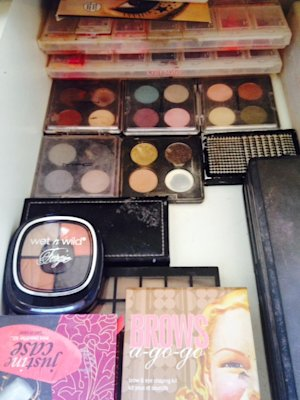 An entire drawer full of palettes with one used up eyeshadow!