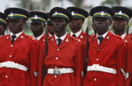 Nigeria police parade during the inauguration ceremony of Nigerian President Goodluck Jonathan at the main parade ground in Nigeria's capital of Abuja Sunday, May 29, 2011. Goodluck Jonathan was sworn in Sunday for a full four-year term as president of Nigeria and is now faced with the challenge of uniting a country that saw deadly postelection violence despite what observers called the fairest vote in over a decade.