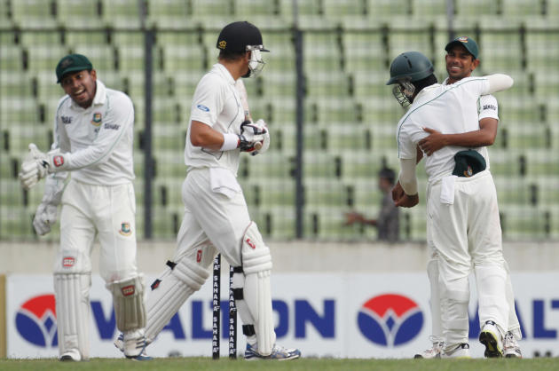 New Zealand's Wagner leaves the field as Bangladesh's Rahim and Ayub celebrate his dismissal with other player, during their third day of second test cricket match of the series in Dhaka.