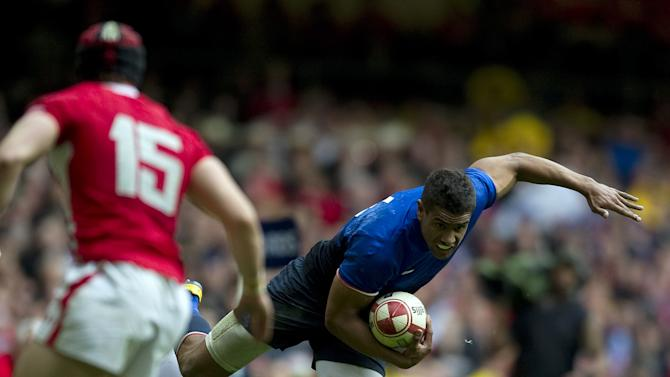 France wing Wesley Fofana (R) is tackled by Wales' centre Jonathan Davies (2nd R) during the Six Nations International rugby union match between Wales and France at the Millennium Stadium in Cardiff, Wales, on March 17, 2012. AFP PHOTO/ADRIAN DENNIS   RESTRICTED TO EDITORIAL USE. (Photo credit should read ADRIAN DENNIS/AFP/Getty Images)