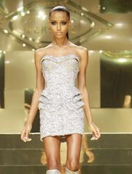 A model wears a creation by Fashion designer Donatella Versace as part of her Women's Spring Summer 2012/2013 fashion collection presented in Paris, Monday, Jan. 23, 2012. (AP Photo/ Jacques Brinon)