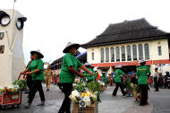 Handouts: The sellers of Pasar Gede market joined the parade bringing handouts for the earth. (