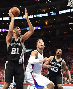 LOS ANGELES, CA - APRIL 22: Tim Duncan #21 of the San Antonio Spurs shoots over Blake Griffin #32 of the Los Angeles Clippers as Boris Diaw #33 look on during Game Two of the Western Conference quarterfinals of the 2015 NBA Playoffs at Staples Center on April 22, 2015 in Los Angeles, California. NOTE TO USER: User expressly acknowledges and agrees that, by downloading and or using this Photograph, user is consenting to the terms and condition of the Getty Images License Agreement. The Spurs won 111-107. (Photo by Harry How/Getty Images)