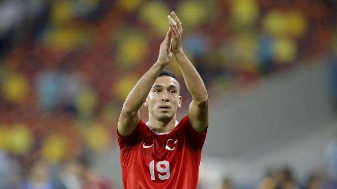 Turkey's Mevlut Erdinc celebrates after scoring his team's second goal during a World Cup Group D qualifying soccer match between Romania and Turkey at the National Arena stadium in Bucharest, Romania, Tuesday, Sept. 10, 2013. Turkey beat Romania 2-0