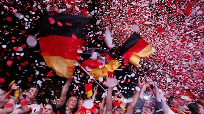 TOPSHOTS Supporters Of The German National Football Team Cheer With German Flags At The End Of The Public Screening Of  AFP/Getty Images