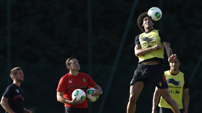 Belgian national soccer team player Fellaini heads a ball during a training session in Brussels