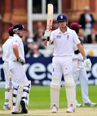 England cricketer Alistair Cook (right) reaches his half-century at Lords cricket ground in London. Cook and Ian Bell led England to victory in the first Test against the West Indies