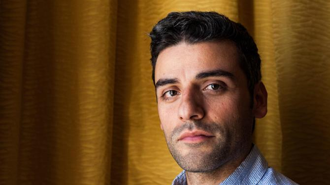 Actor Oscar Isaac poses for portraits at the 66th international film festival, in Cannes, southern France, Monday, May 20, 2013. (AP Photo/Laurent Emmanuel)