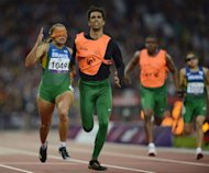 Brazil's Terezinha Guilhermina (L) runs with her guide Guilherme Soares de Santana to win the Women's 200 metres T11 athletics Final during the London 2012 Paralympic Games on September 2, 2012