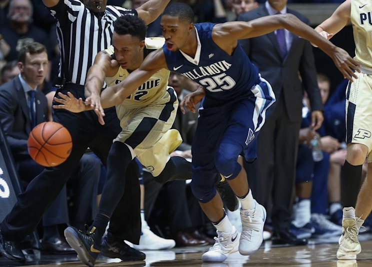 Villanova's Mikal Bridges and Purdue's Vince Edwards battle for a loose ball (Getty Images)