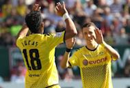 Dortmund's striker Lucas Barrios (L) celebrates with midfielder Ivan Perisic after a goal during the German first division football match against Kaiserslautern. The German champions Borussia Dortmund have closed in on another record as their 5-2 win over relegated Kaiserslautern took their unbeaten run to 27 league games
