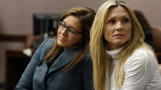 """FILE - This Nov. 27, 2012 file photo shows attorney Ellen Torregrossa-O'Connor, left, holding the hand of former """"Melrose Place"""" actress Amy Locane-Bovenizer, 40, of Hopewell Township, N.J. as the jury in her trial returns a verdict in Somerville, N.J.  Locane-Bovenizer, who was driving drunk when her SUV plowed into a car and killed a New Jersey woman, was sentenced Thursday, Feb. 14, 2013, to three years in prison.   (AP Photo/The Star-Ledger, Robert Sciarrino, filel)"""