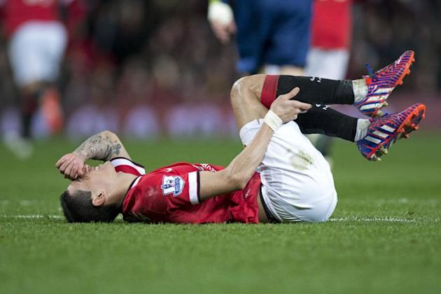 Manchester United's Angel Di Maria lies on the pitch during their FA Cup quarter-final against Arsenal at Old Trafford in Manchester, north-west England, on March 9, 2015