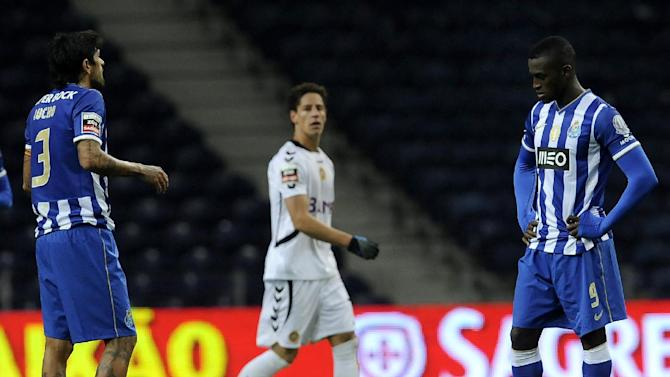 FC Porto's Lucho Gonzalez, left, from Argentina and Jackson Martinez, from Colombia, react after the equalizer goal from Nacional's Mario Rondon, centre, from Venezuela in a Portuguese League soccer match at the Dragao stadium in Porto, Portugal, Saturday, Nov. 23, 2013. Rondon and Jackson Martinez scored once in a match that ended in a 1-1 draw
