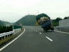 Dramatic Video Shows Dangerously Overloaded Truck Turning Over On Highway