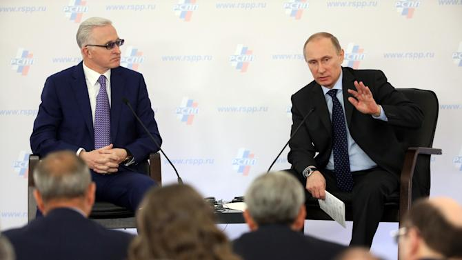 The head of the Russian Union of Industrialists and Entrepreneurs Alexander Shokhin, left, listens as Russia's President Vladimir Putin speaks at a congress of the Russian Union of Industrialists and Entrepreneurs in Moscow, Russia, on Thursday, March 20, 2014. (AP Photo/ Sergei Chirikov, pool)