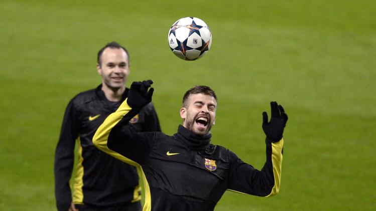 Barcelona's Gerard Pique jumps for the ball during a training session in Manchester