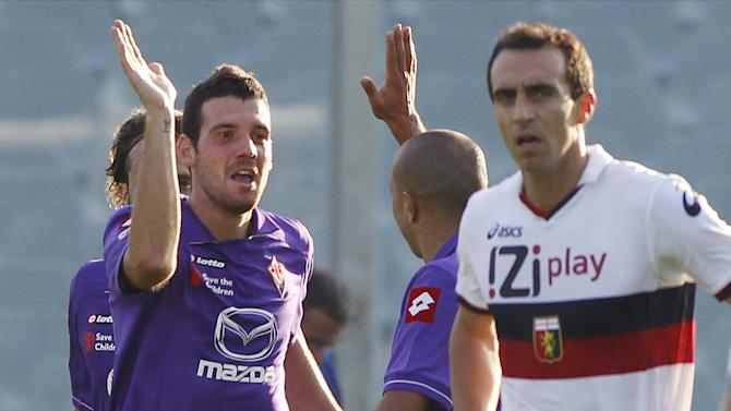 Fiorentina's Andrea Lazzari  celebrates after scoring during a Serie A soccer match between Fiorentina and Genoa at the Artemio Franchi stadium in Florence,  Italy  Sunday , Oct.  30, 2011. (AP Photo/Fabrizio Giovannozzi)