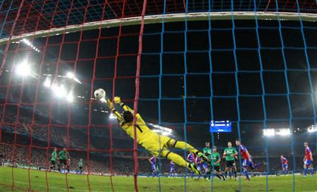 Schalke 04's Draxler scores past Basel's Sommer during Champions League soccer match in Basel