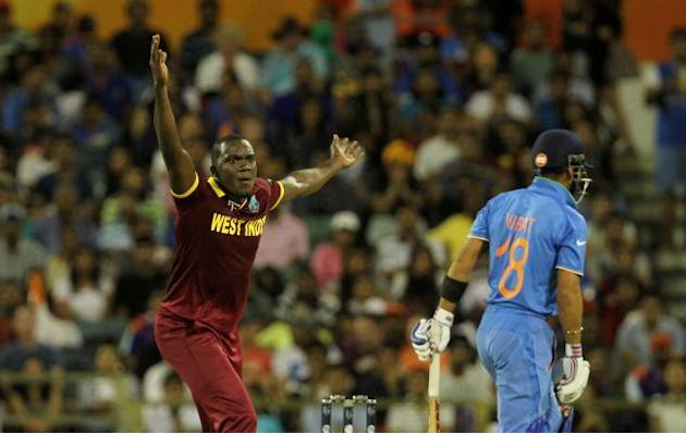 Perth: West Indian player Jerome Taylor and Indian batsman Virat Kohli during an ICC World Cup 2015 match between India and West Indies at Western Australia Cricket Association Ground, Perth, Australi