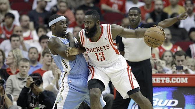 Houston Rockets' James Harden (13) pushes against Denver Nuggets' Ty Lawson in the first half of an NBA basketball game Saturday, Nov. 16, 2013, in Houston