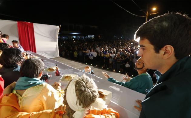 Actors take part in a re-enactment during a Holy Week procession to prepare for Good Friday celebrations, in Luque