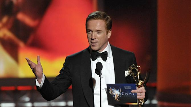 """Damian Lewis accepts the award for Outstanding Lead Actor In A Drama Series for """"Homeland"""" at the 64th Primetime Emmy Awards at the Nokia Theatre on Sunday, Sept. 23, 2012, in Los Angeles. (Photo by John Shearer/Invision/AP)"""