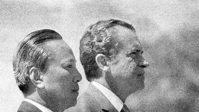 In this April 2, 1973 photo, President Richard Nixon and South Vietnamese President Nguyen Van Thieu are in profile as they listen to national anthems during arrival ceremonies for Thieu at the Western White House in San Clemente, Calif. As the last U.S. combat troops left Vietnam 40 years ago, angry protesters still awaited them at home. North Vietnamese soldiers took heart from their foes' departure, and South Vietnamese who had helped the Americans feared for the future. While the fall of Saigon two years later — with its indelible images of frantic helicopter evacuations — is remembered as the final day of the Vietnam War, Friday marks an anniversary that holds greater meaning for many who fought, protested or otherwise lived it. (AP Photo)