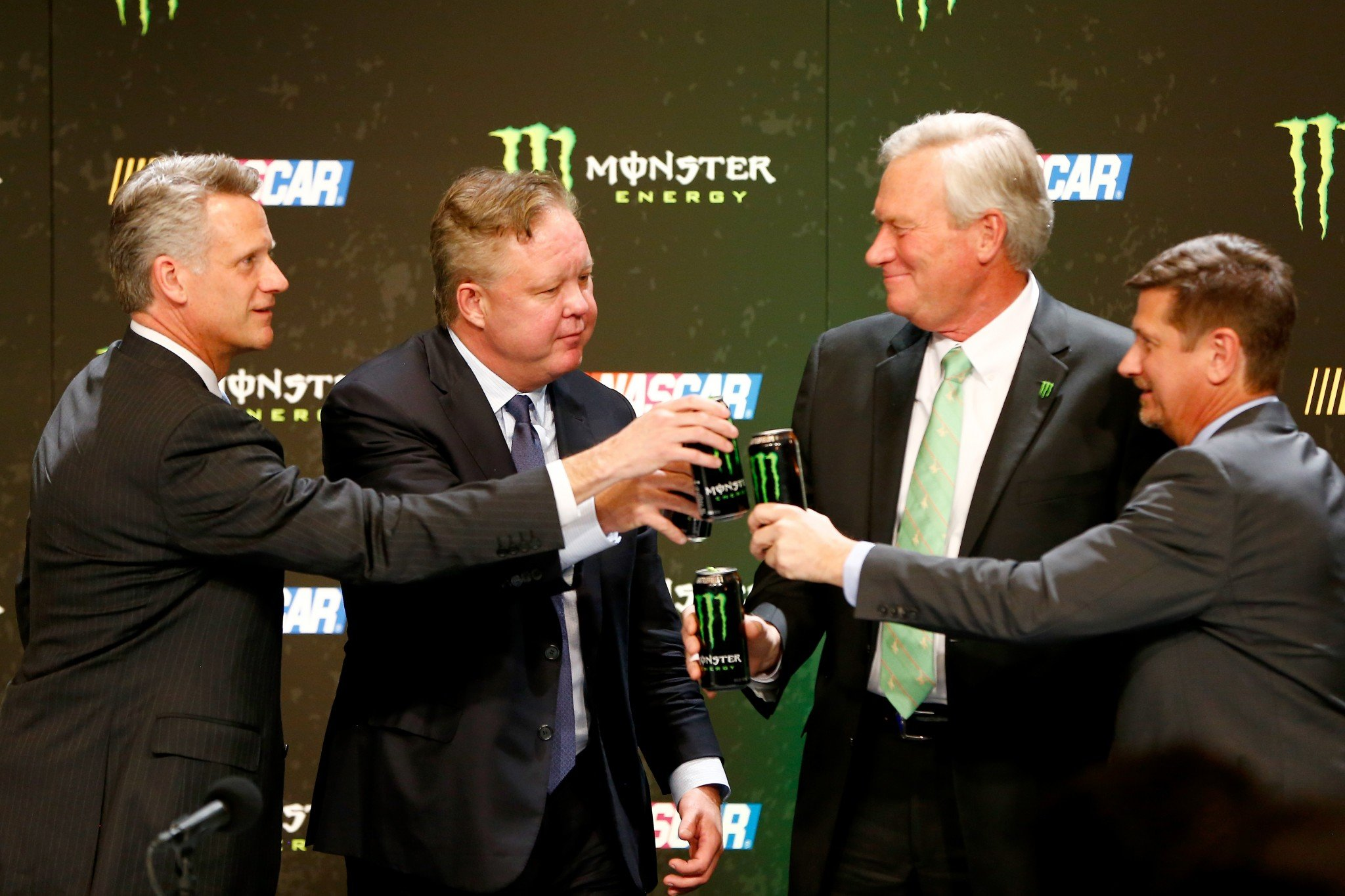 NASCAR and Monster executives toast the sponsorship announcement. (Getty)