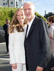 "Director James Cameron (R) and Suzy Amis at the world premiere of ""The Hobbit"" movie in Courtenay Place in Wellington on November 28, 2012"