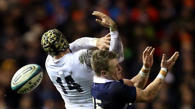 England's Jack Nowell, left, is tackled by Scotland's Stuart Hogg, right, during their Six Nations rugby union international match at Murrayfield, Edinburgh, Scotland, Saturday Feb. 8, 2014. (AP Photo/Scott Heppell)