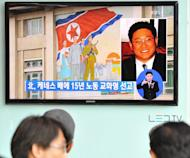"""People in Seoul watch a TV report May 2, 2013 on Kenneth Bae, a Korean-American tour operator detained in North Korea. North Korea said Sunday it would not invite any leading US figure to seek the release of a jailed American, adding he would not be a """"political bargaining chip"""" in any negotiations with the United States"""