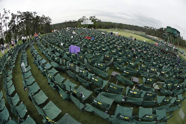 Empty chairs surround the 18th green at Augusta National. (AP)