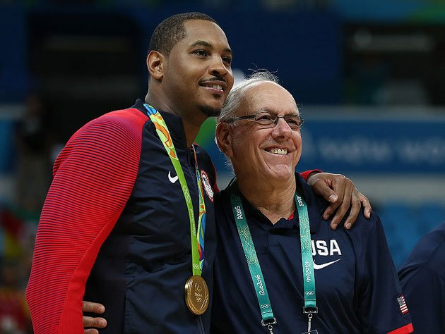 Carmelo Anthony and Jim Boeheim take in the gold. (Getty Images)