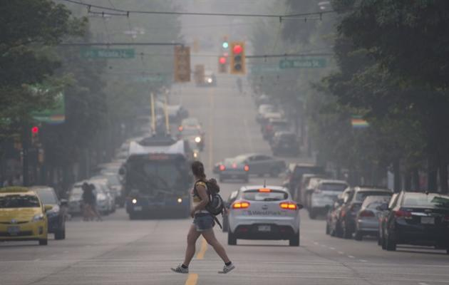 Smoke from wildfires in the interior of British Columbia blanket downtown Vancouver, B.C. Sunday, July 5 2015. THE CANADIAN PRESS/Jonathan Hayward