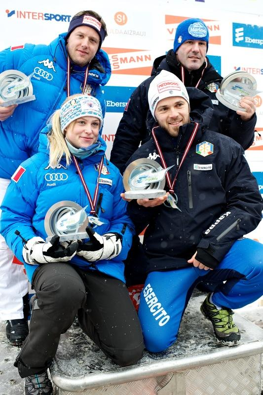 Italy's Sandra Gasparini (2L), Christian Oberstolz (2R), Patrick Gruber (L) And Armin Zoggeler Celebrate AFP/Getty Images