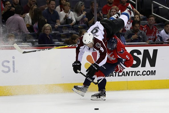 WASHINGTON, DC - OCTOBER 18: Matt Duchene #9 of the Colorado Avalanche flips over Dmitry Orlov #9 of the Washington Capitals in the first period at Verizon Center on October 18, 2016 in Washington, DC. (Photo by Rob Carr/Getty Images)