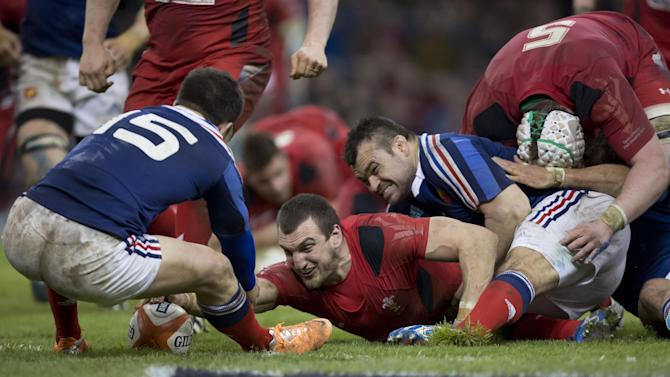 Wales' captain Sam Warburton scores a try against France during their Six Nations rugby union international match at the Millennium Stadium, Cardiff, Wales, Friday, Feb. 21, 2014. (AP Photo/Jon Super)