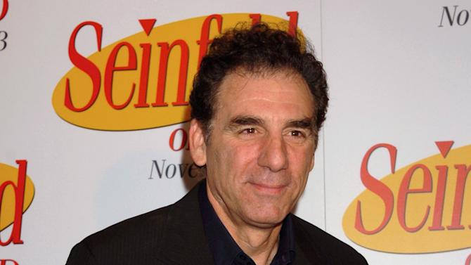 """FILE - This Nov. 17, 2004 file photo shows actor-comedian Michael Richards at the release of the first three seasons of the """"Seinfeld"""" on DVD in New York. TV Land says it has cast Richards in a pilot for a prospective new sitcom. The series, """"Giant Baby,"""" would also feature fellow """"Cheers"""" alums Kirstie Alley and Rhea Perlman. The pilot will be taped next week, the network said Tuesday, dec. 4, 2012. """"Giant Baby"""" focuses on Maddie Banks, a Broadway star played by Alley. Richards plays her limo driver while Perlman plays her assistant. (AP Photo/ Louis Lanzano)"""