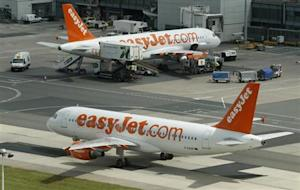 An Easy Jet aircraft taxis across the tarmac at Manchester Airport