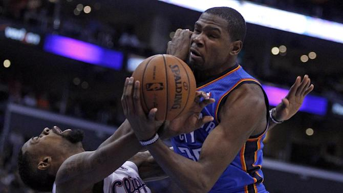 Oklahoma City Thunder forward Kevin Durant, right, collides with Los Angeles Clippers center DeAndre Jordan, left, going to the basket in the second half of their NBA basketball game Wednesday, Nov. 13, 2013, in Los Angeles. The Clippers won the game 111-103